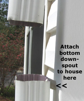 Cut a gap in the downspout an inch or two smaller than the height of the catch basin.  Photo by Stibolt.