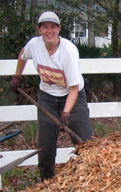 Ginny Stibolt with a pile of mulch.  Typical!