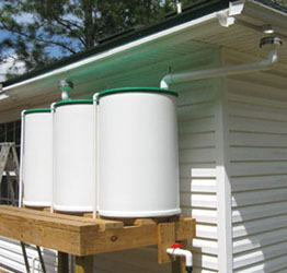 Ginny's three new rain barrels are elevated on a 4'-high deck.  Photo by Stibolt.